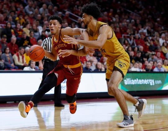 Iowa State guard Lindell Wigginton, left, drives past Alabama State's Branden Johnson on Tuesday.