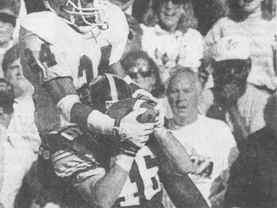 From September 1991: Iowa Hawkeyes tight end Matt Whitaker (46) fights for the ball with Northern Illinois' defensive back Vaurice Patterson.