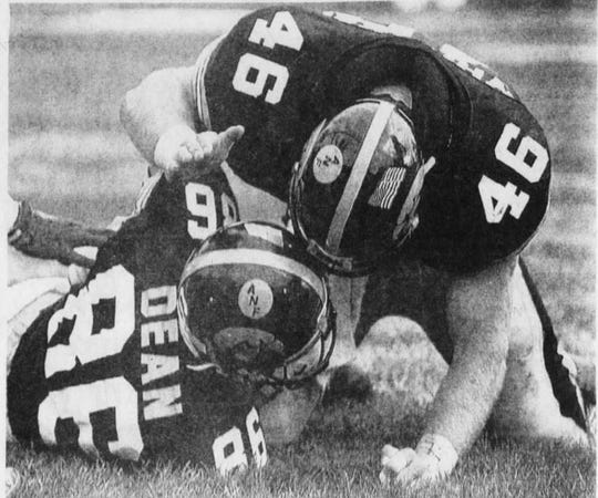From October 1992: Anthony Dean is congratulated by teammate Matt Whitaker (46) after Dean caught a pass from Iowa quarterback Jim Hartlieb for a 2-point conversation — the winning points — in the fourth quarter of the Hawkeyes' 23-22 victory against Wisconsin.