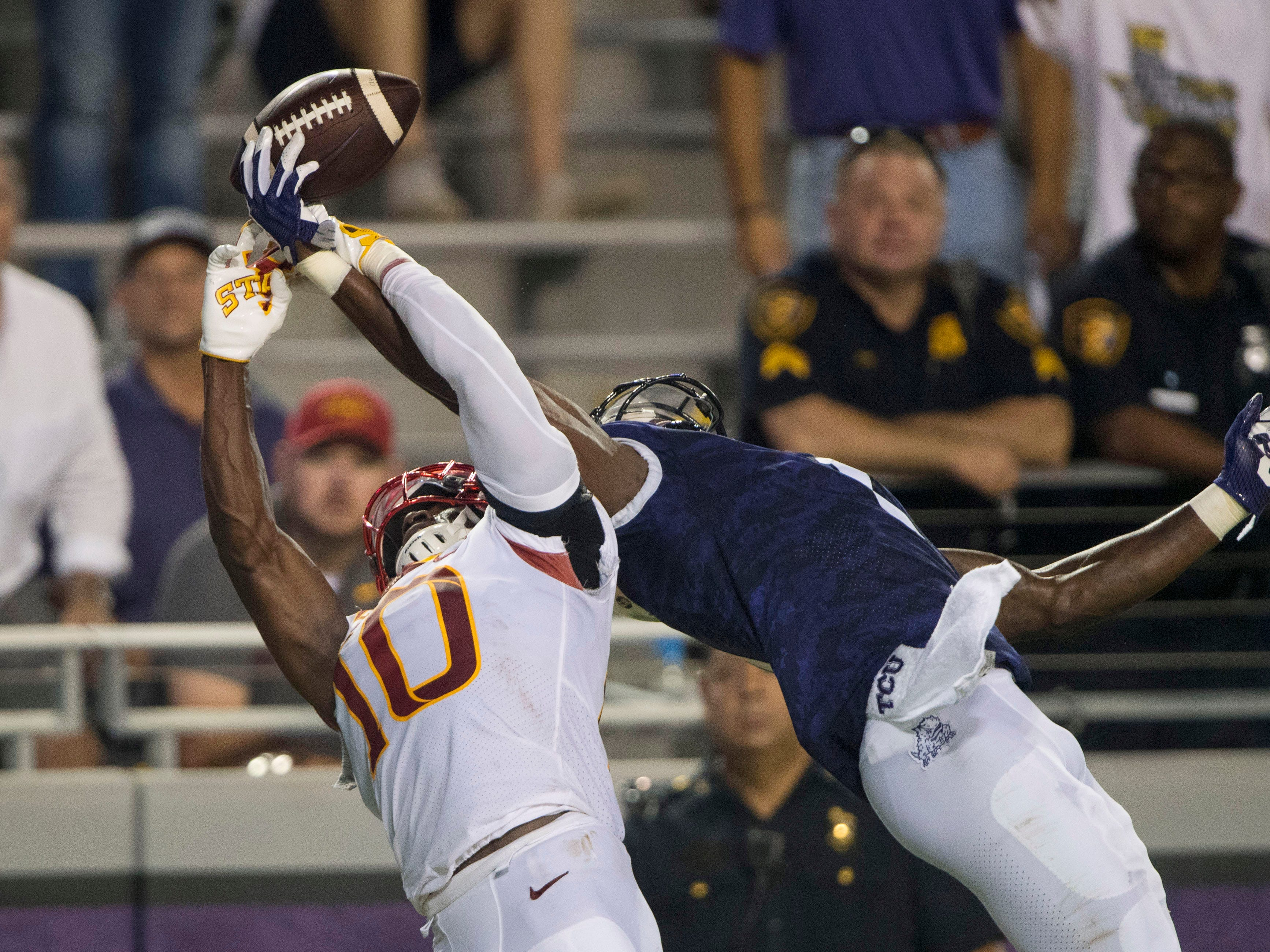 Iowa State Cyclones defensive back Brian Peavy (10) and TCU Horned Frogs wide receiver Jalen Reagor (1) fight for the ball during the second half at Amon G. Carter Stadium.