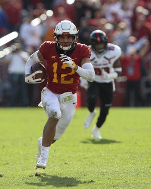 Iowa State Cyclones defensive back Greg Eisworth (12) runs the football after his interception against the Texas Tech Red Raiders at Jack Trice Stadium. The Cyclones beat the Red Raiders 40 to 31.