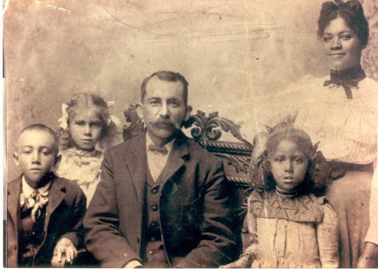 Minneapolis resident Denise Muhammad believes Emmerson Doyle, the brother of her great-grandfather, is buried in Enterprise Cemetery. Doyle, middle, is pictured here with, from left, his son Robert, daughter Minnie, daughter Madeline and wife Martha.