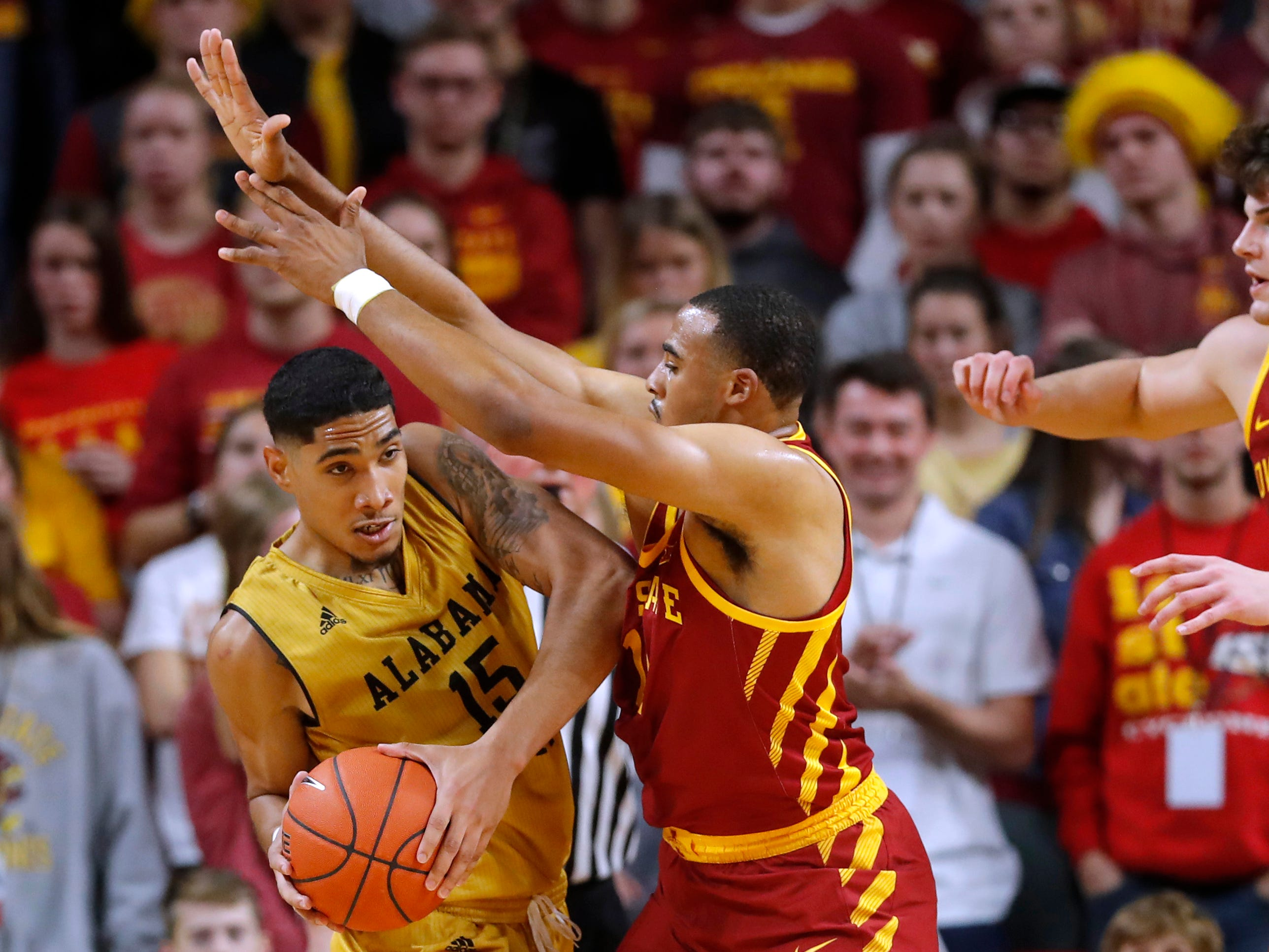Alabama State forward Fausto Pichardo, left, looks to pass around Iowa State guard Talen Horton-Tucker in Iowa State's season opener Tuesday.