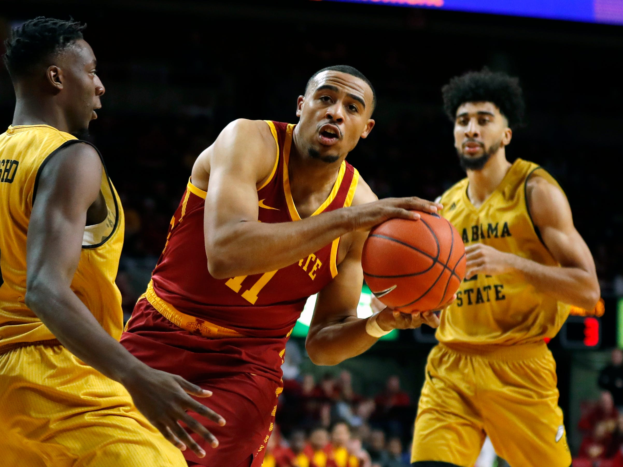 Iowa State guard Talen Horton-Tucker (11) drives to the basket past Alabama State guard Tobi Ewuosho, left, during the first half of an NCAA college basketball game, Tuesday, Nov. 6, 2018, in Ames, Iowa. (AP Photo/Charlie Neibergall)
