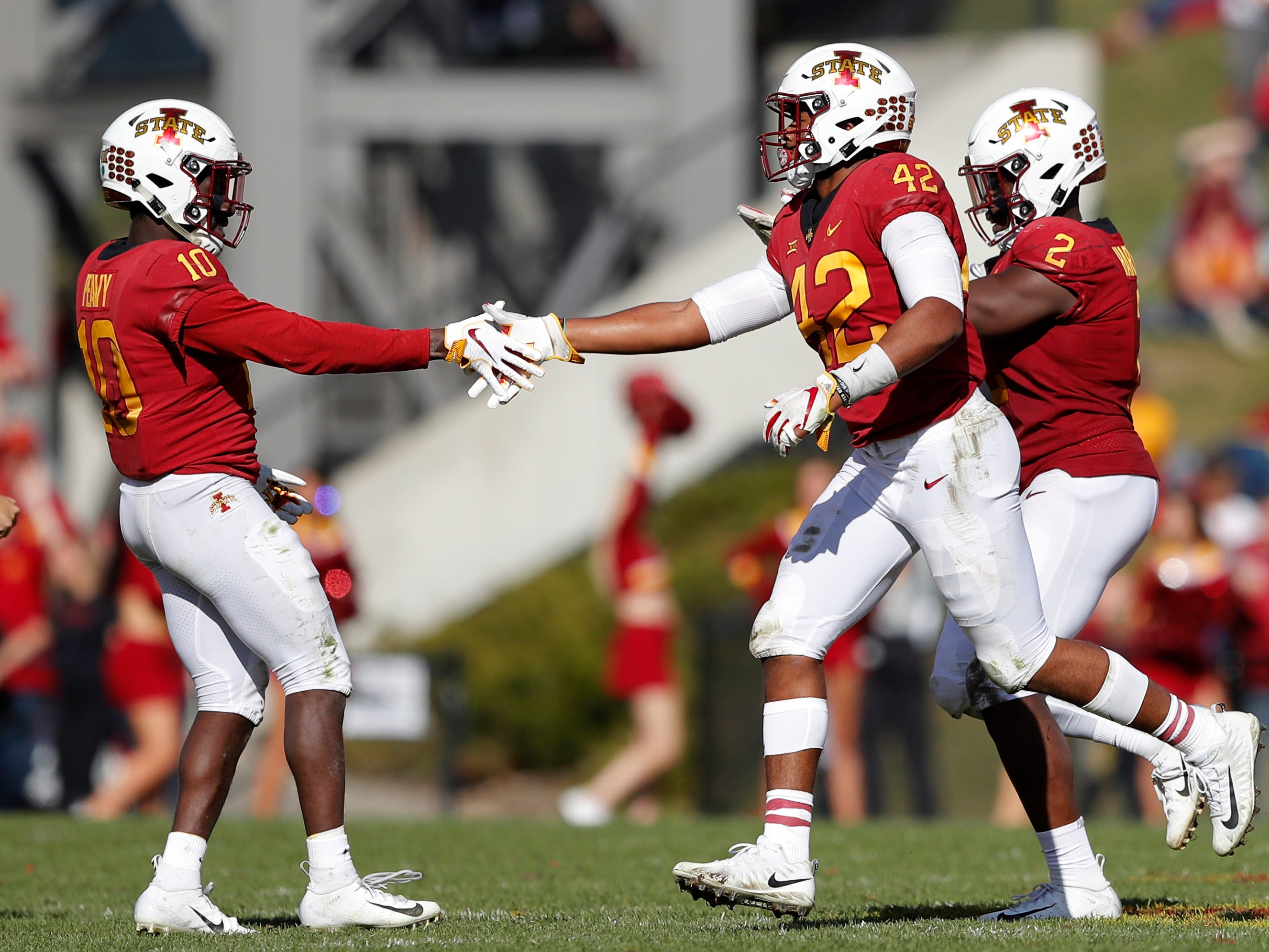 Iowa State linebacker Marcel Spears Jr. (42) celebrates with teammate Brian Peavy (10) after intercepting a pass during the second half of an NCAA college football game against Texas Tech, Saturday, Oct. 27, 2018, in Ames, Iowa.