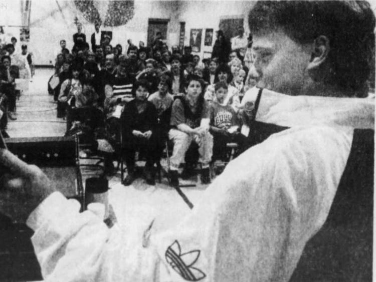 From April 1992: University of Iowa Hawkeyes tight end Matt Whitaker, an Ankeny High School graduate, reads a book to students and their families at Ankeny's Northwest Elementary.