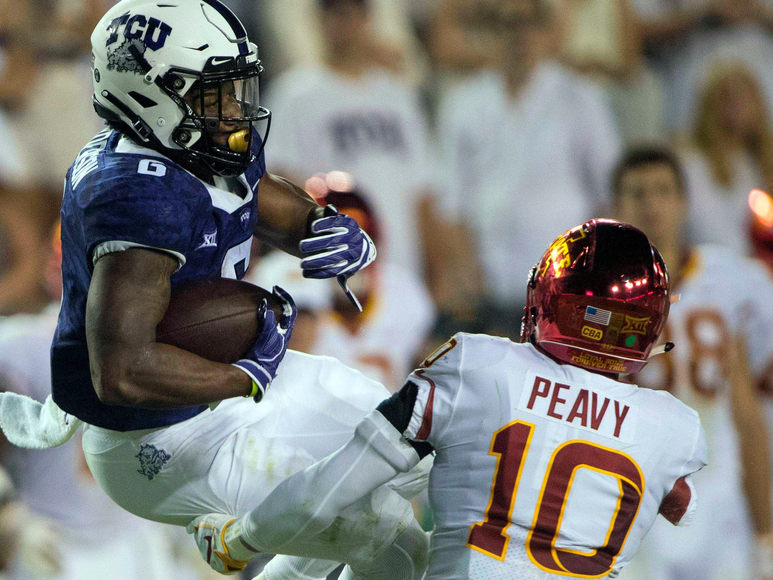 TCU Horned Frogs running back Darius Anderson (6) is brought down by Iowa State Cyclones defensive back Brian Peavy (10) during the second half at Amon G. Carter Stadium.