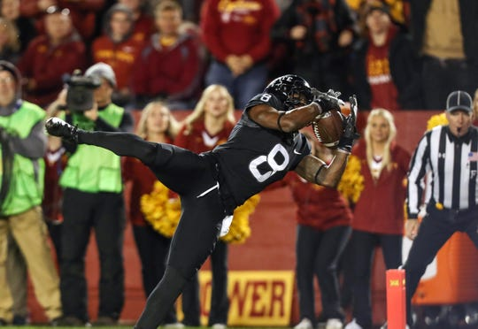 Iowa State Cyclones wide receiver Deshaunte Jones (8) catches a touchdown pass in the fourth quarter against the West Virginia Mountaineers at Jack Trice Stadium. Iowa State beat West Virginia 30-14.