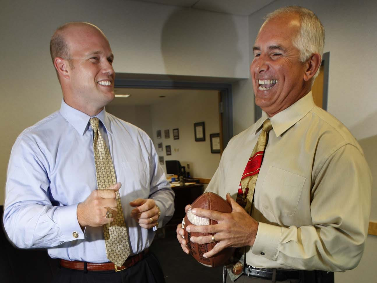 From September 2009: Former Iowa Hawkeyes tight end Matt Whitaker (left), now a U.S. Attorney for the southern district of Iowa, and former Iowa State quarterback John Quinn, now the Director of the division of criminal investigations in Iowa, pose for a photo in Whitaker's office.
