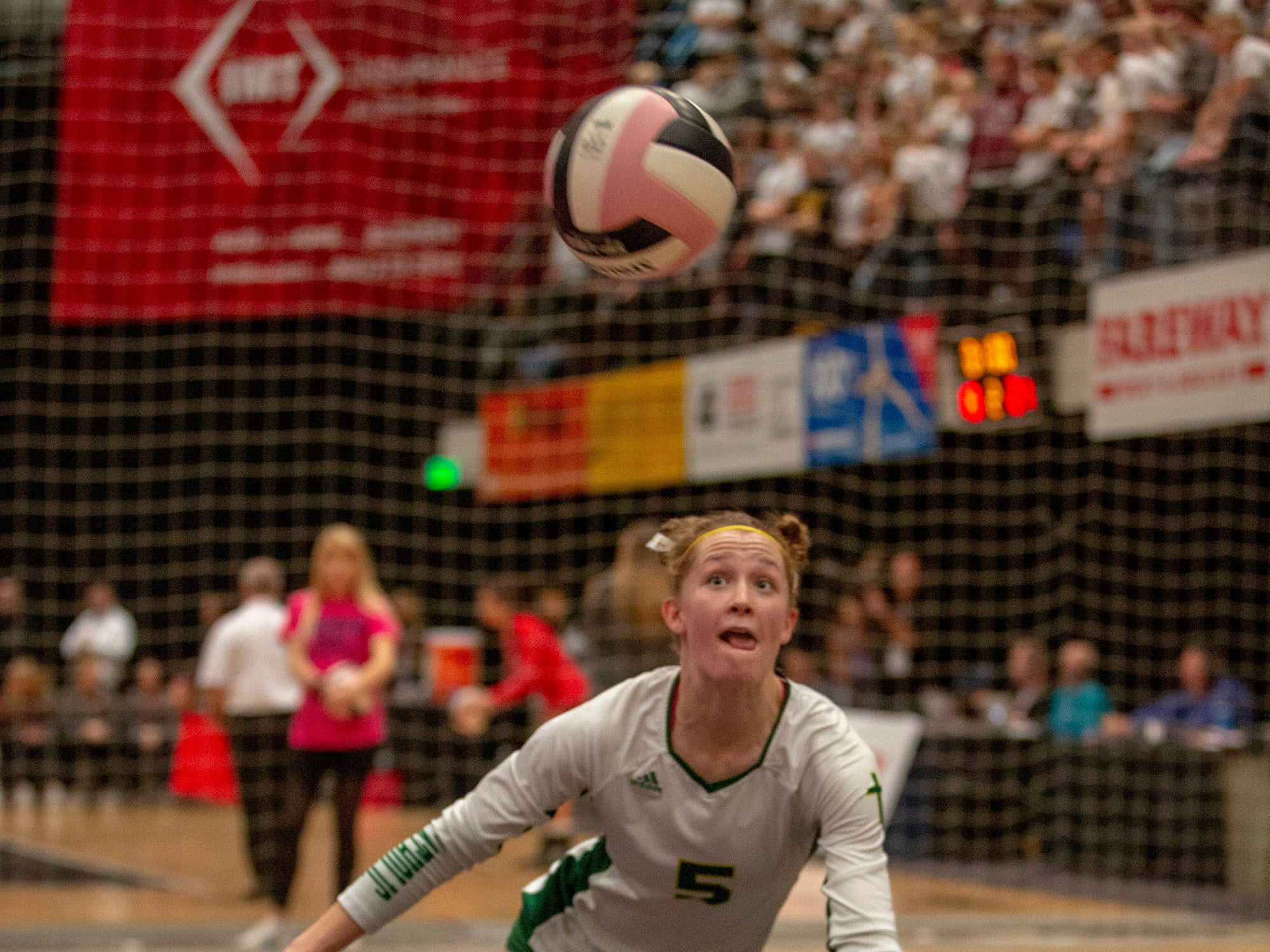 Heather Boeckenstadt of Beckman dives for the ball during quarterfinal action at the Iowa girls state volleyball tournament in Cedar Rapids.