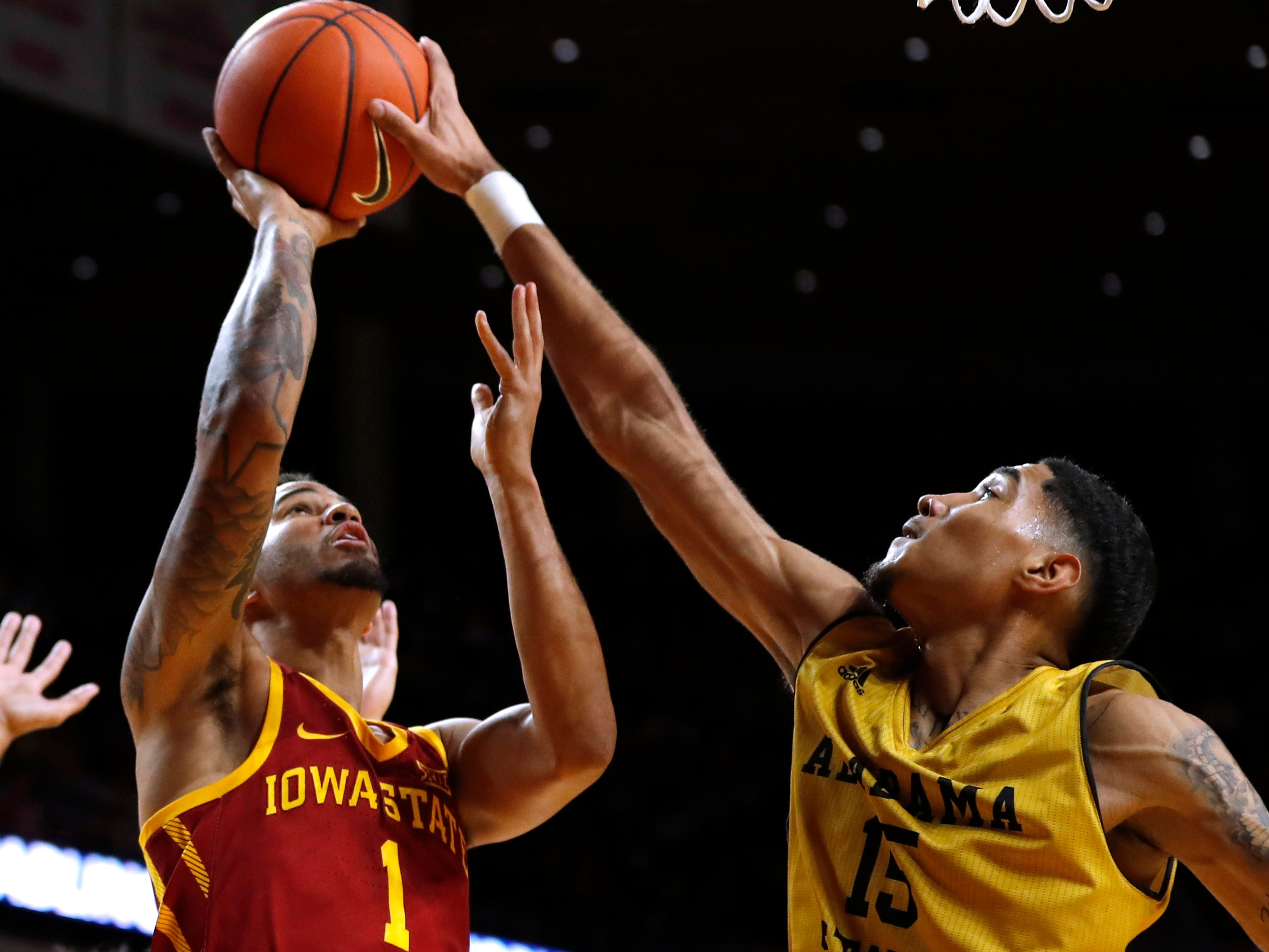 Alabama State forward Fausto Pichardo blocks a shot by Iowa State guard Nick Weiler-Babb, left, during the first half Tuesday in Ames.