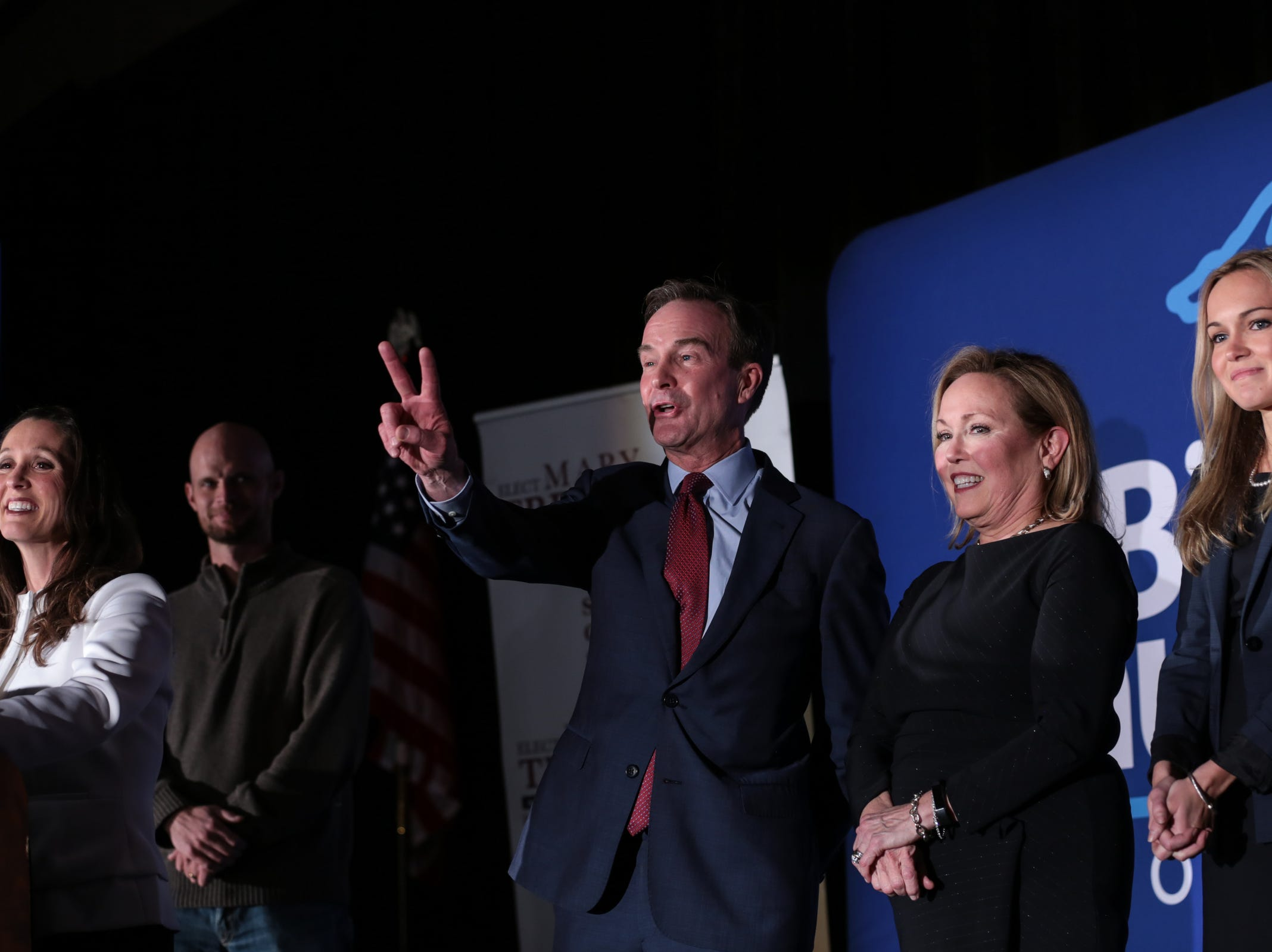 Republican gubernatorial candidate Bill Schuette signals for wanting two beers after losing in Michigan's midterm election during a Michigan Republican elections night party at the Lansing Center in Lansing on Tuesday, November 6, 2018.