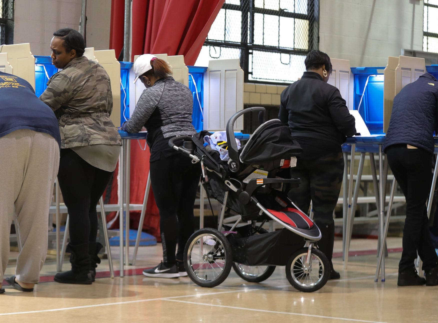 Residents cast their votes on Tuesday, Nov. 6, 2018 at the 7th precinct in Eastpointe, Mich.