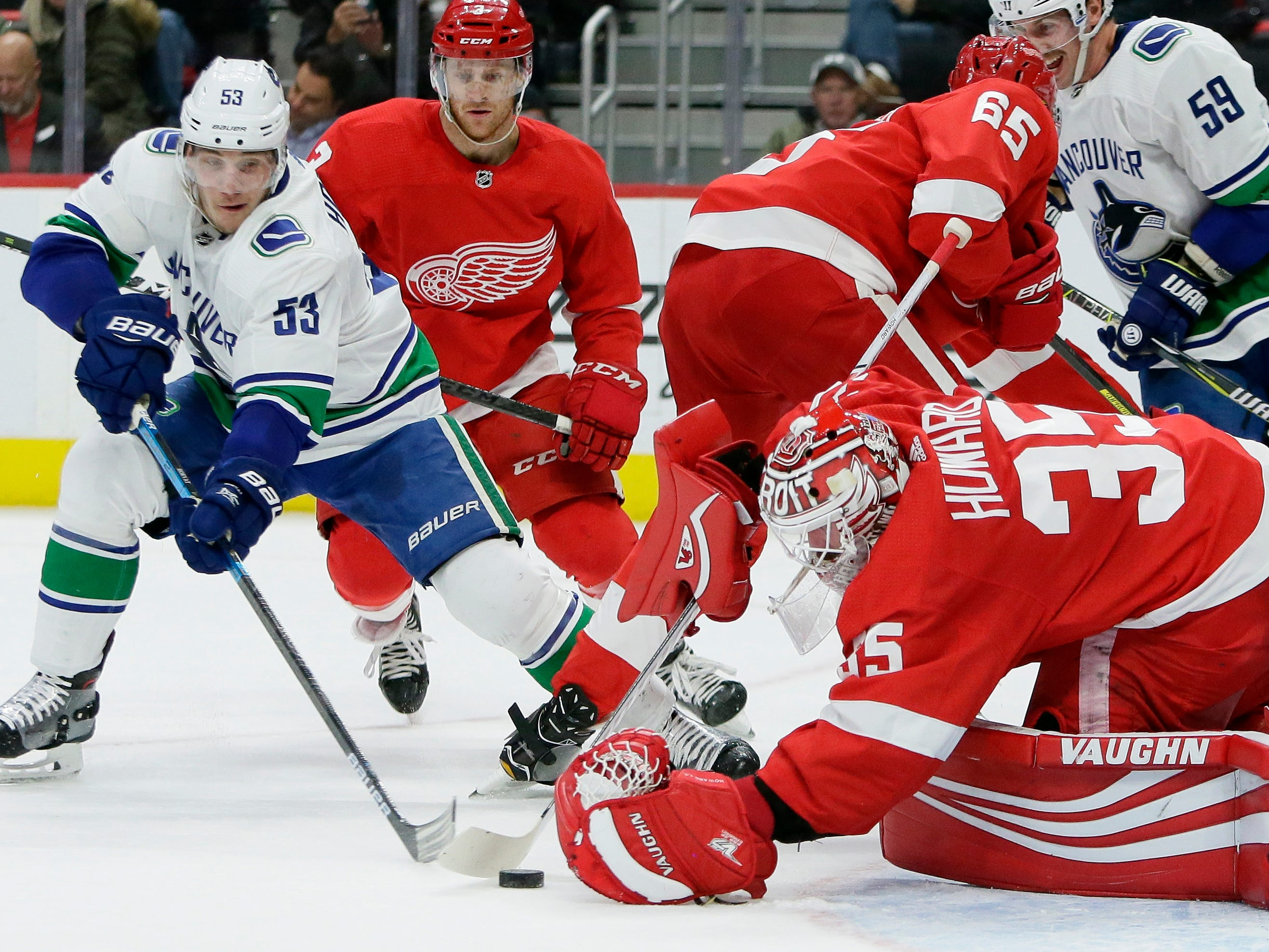 Detroit Red Wings rally out of early hole, top Canucks in SO, 3-2