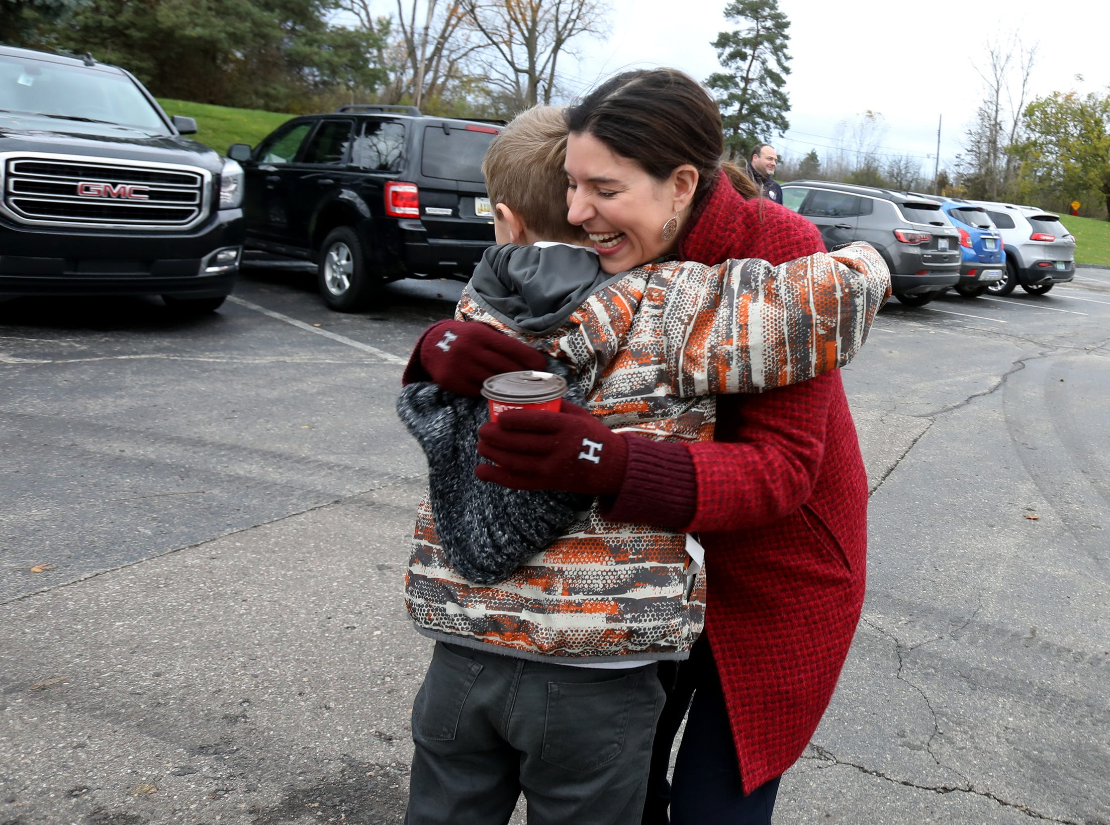 Lena Epstein running for Michigan's 11th congressional district gets a hug from 10-year-old Mike Molenda of Troy who came with his father Paul Molenda to vote at St. Nicholas Greek Orthodox Church in Troy, Michigan on November 6, 2018.Molenda had recognized Epstein from the political ads on TV and wanted to say hi to her.