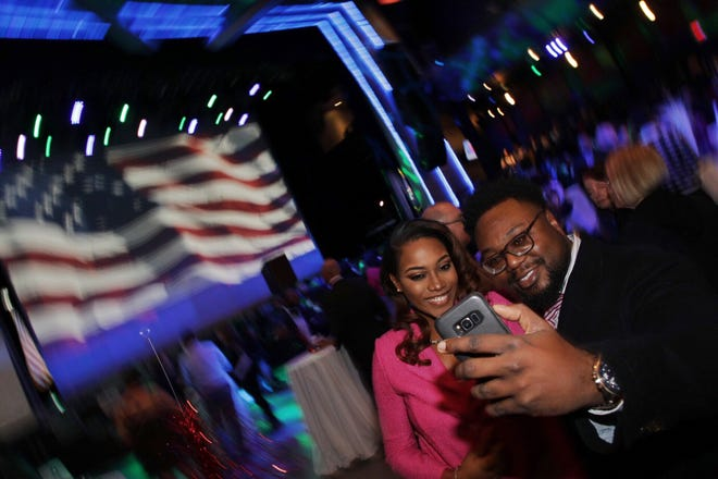 Tiffany Langford, 32 of Southfield and Lamar Willis, 36 of Southfield take a selfie during the Democrat's watch party celebration at MotorCity Casino's Sound Board in Detroit on Tuesday, Nov. 6, 2018.