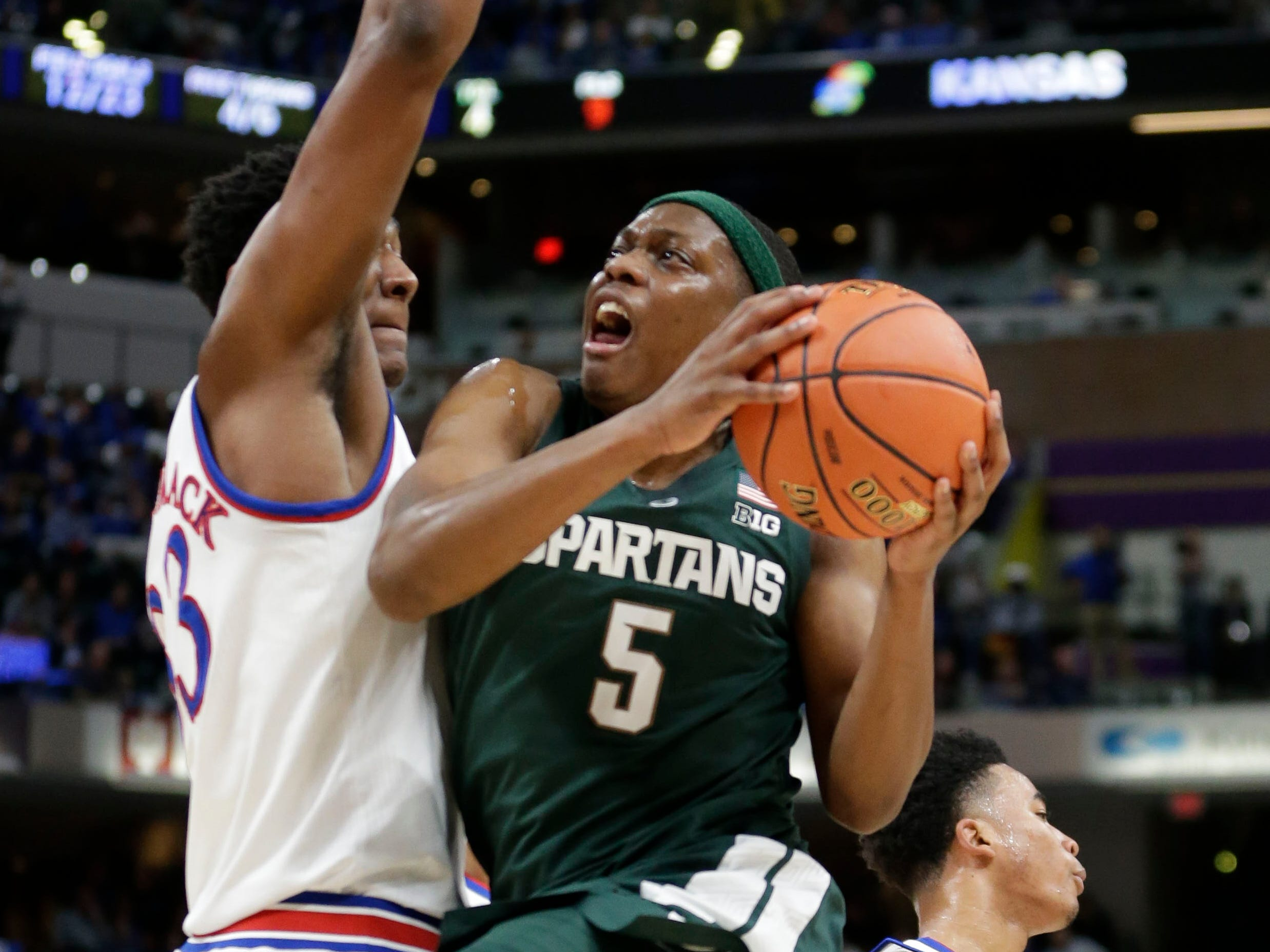 Michigan State guard Cassius Winston tries to shoot around Kansas forward David McCormack in the first half at the Champions Classic in Indianapolis on Tuesday, Nov. 6, 2018.