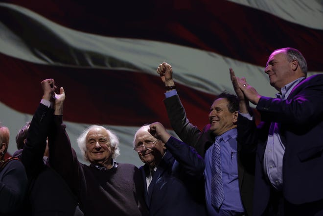Gary Peters, from left, Sander Levin, Carl Levin, Andy Levin and Dan Kildee celebrate U.S. Senator Debbie Stabenow's re-election during the Democratic watch party celebration at MotorCity Casino's Sound Board in Detroit on Tuesday, Nov. 6, 2018.