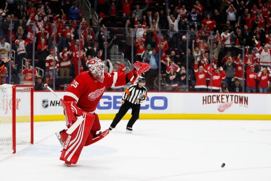 Jimmy Howard reacts after making the winning save during a 3-2 shootout win against the Canucks at Little Caesars Arena.