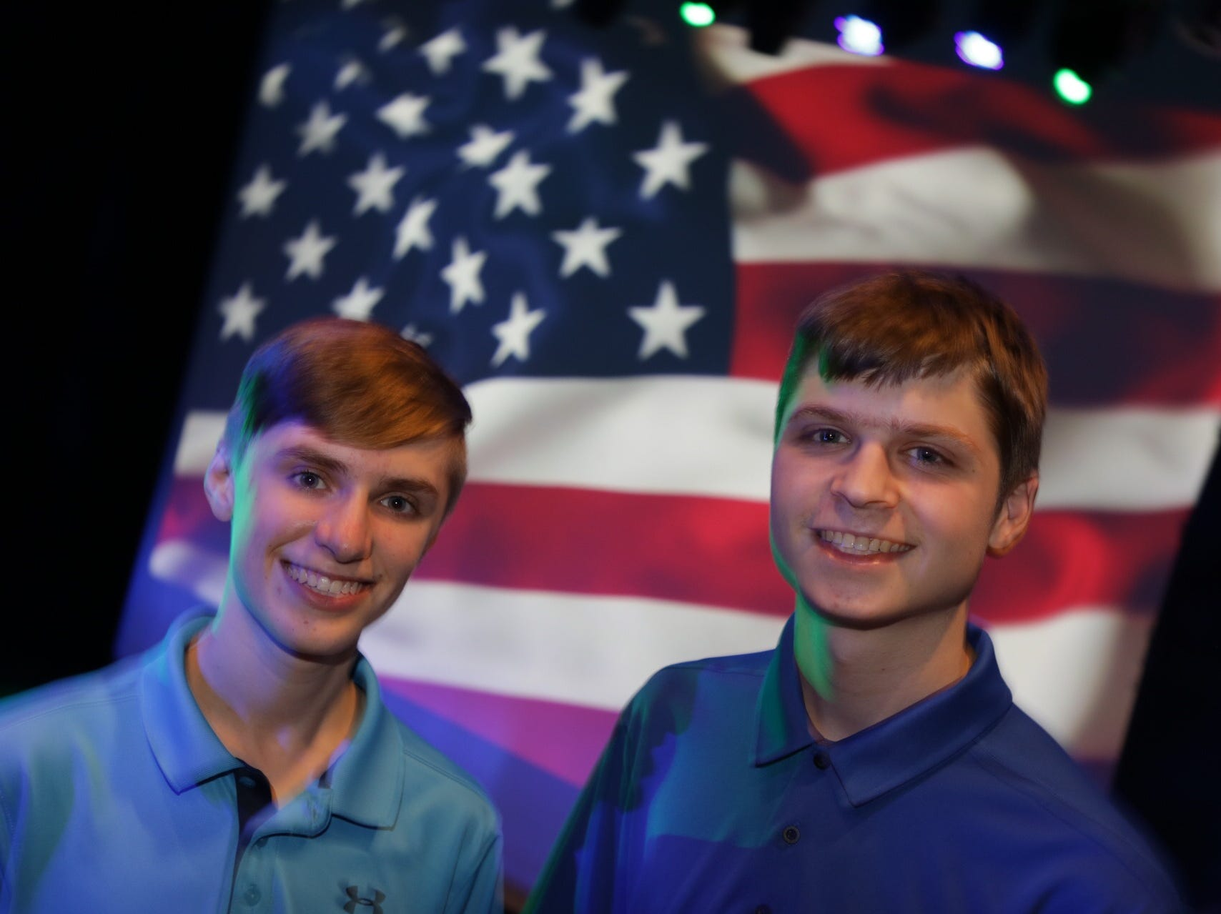 Aidan Johnson-Hill, 16, left and twin brother Brady Johnson- Hill, 16, of Birmingham at the Democratic watch party at MotorCity Casino's Sound Board in Detroit on Tuesday, Nov. 6, 2018.