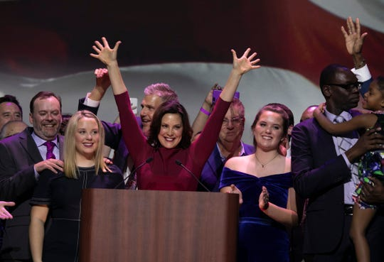 Michigan Governor elect Gretchen Whitmer, flanked by her two daughters, celebrates her victory during the watch party held at the Sound Board in the MotorCity Casino in Detroit Tuesday, Nov. 6, 2018.