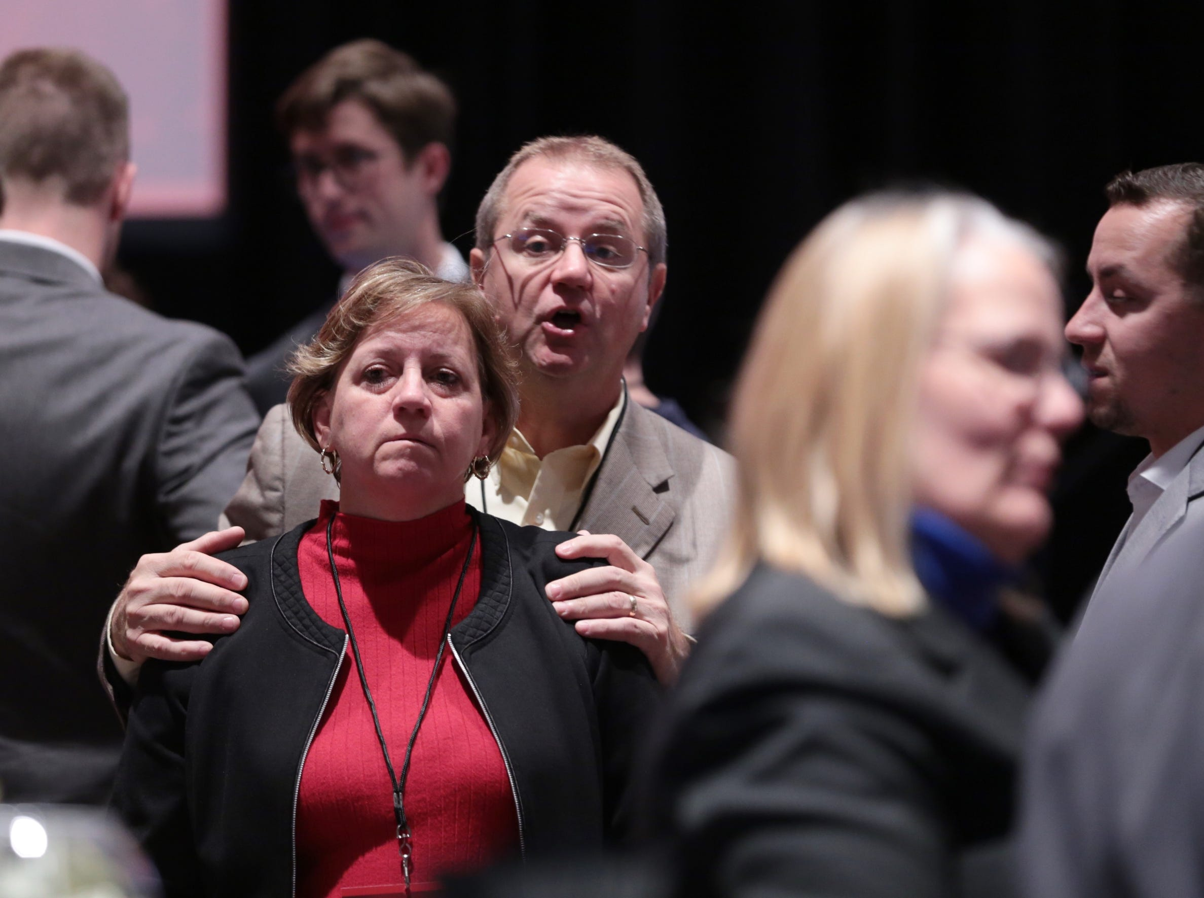 People watch results coming in during an Michigan Republican midterm election night party at the Lansing Center in Lansing on Tuesday, November 6, 2018.