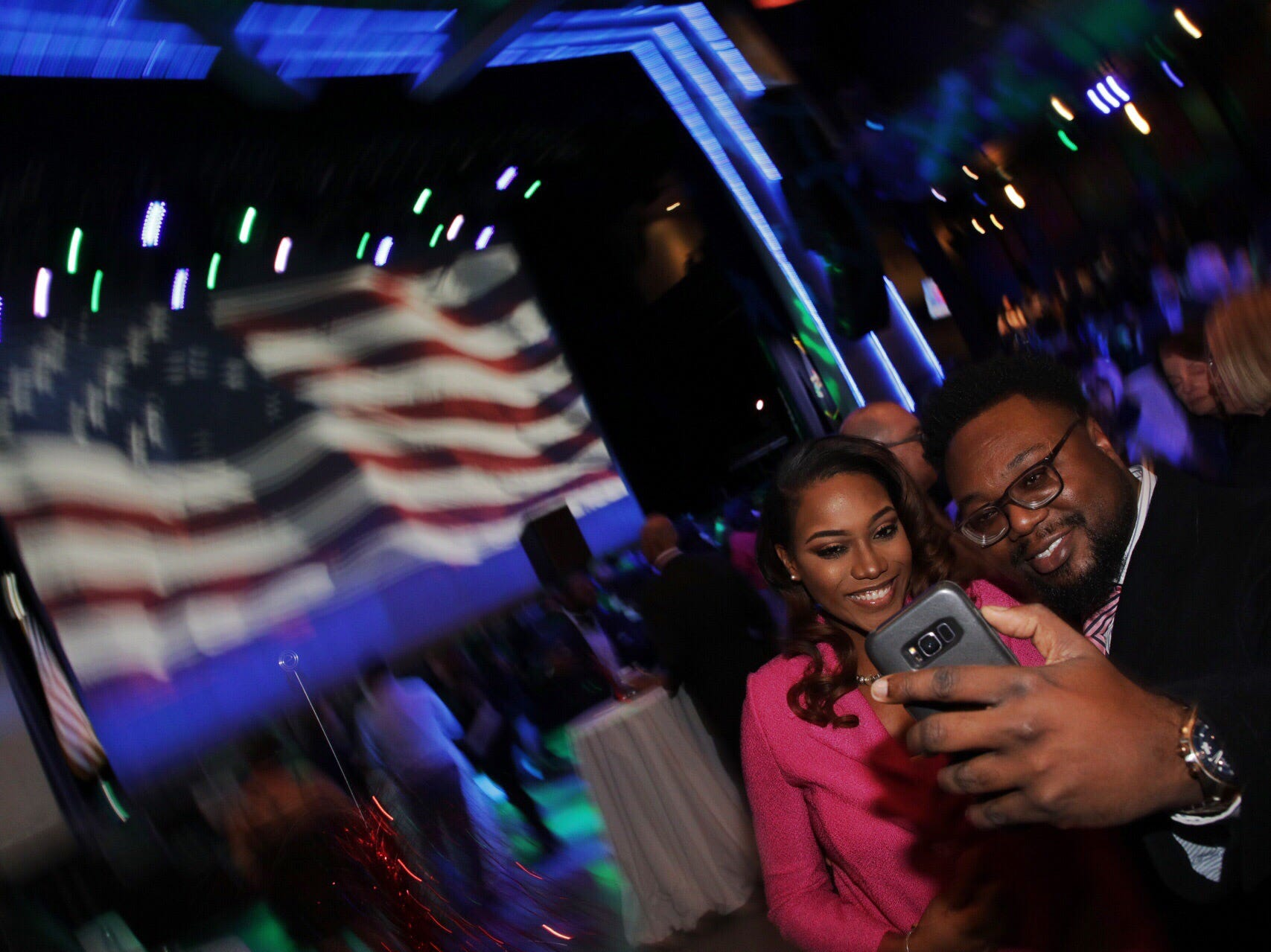 Tiffany Langford, 32, of Southfield and Lamar Willis, 36, of Southfield  take a selfie during the Democrat's watch party celebration at MotorCity Casino's Sound Board in Detroit on Tuesday, Nov. 6, 2018.