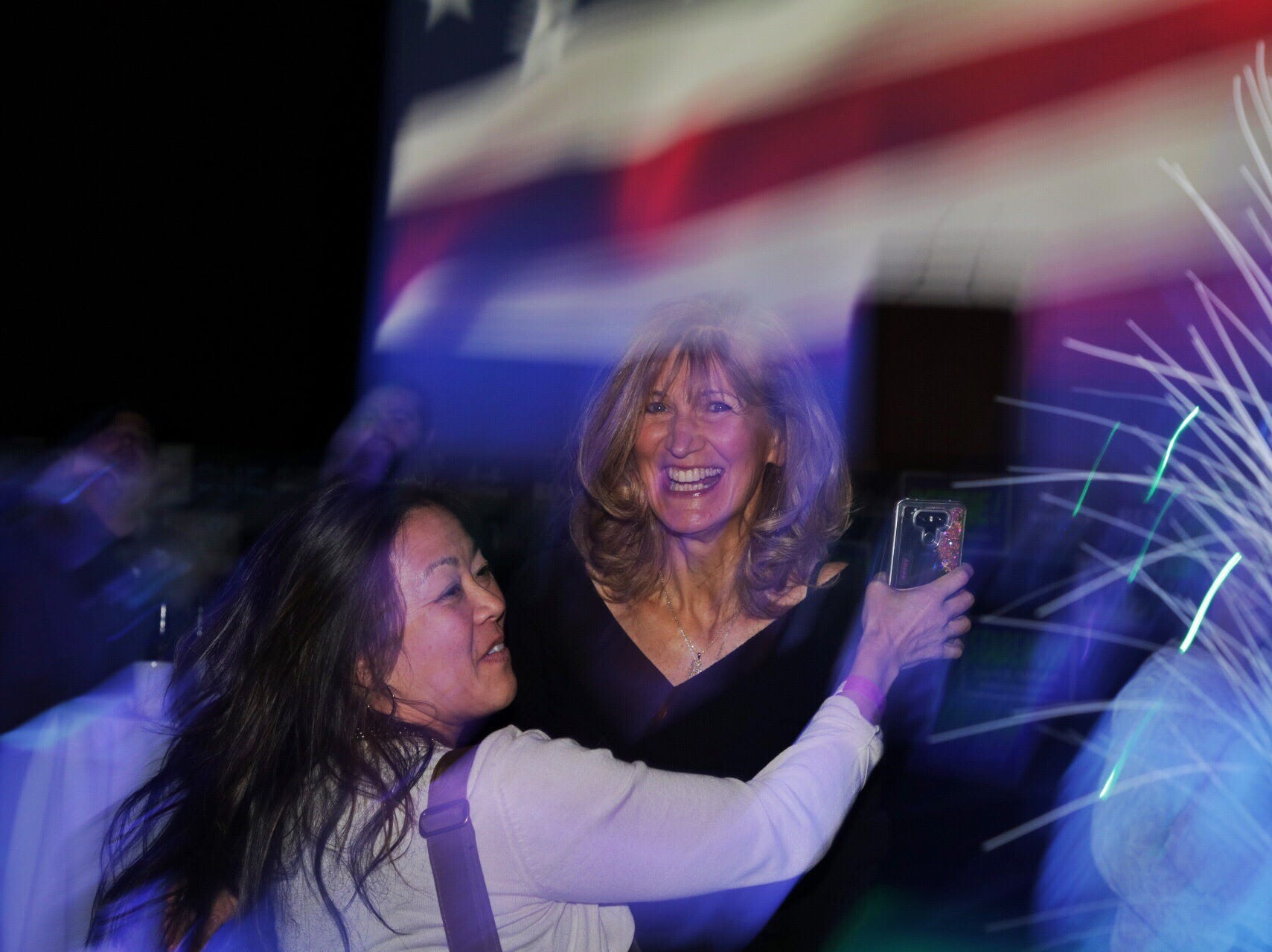 Patricia Paul of Birmingham, right greets Catherine Bansek of Royal Oak both volunteers who worked with Fems for Dems at the watch party for Democrats at MotorCity Casino's Sound Board in Detroit on Tuesday, Nov. 6, 2018.