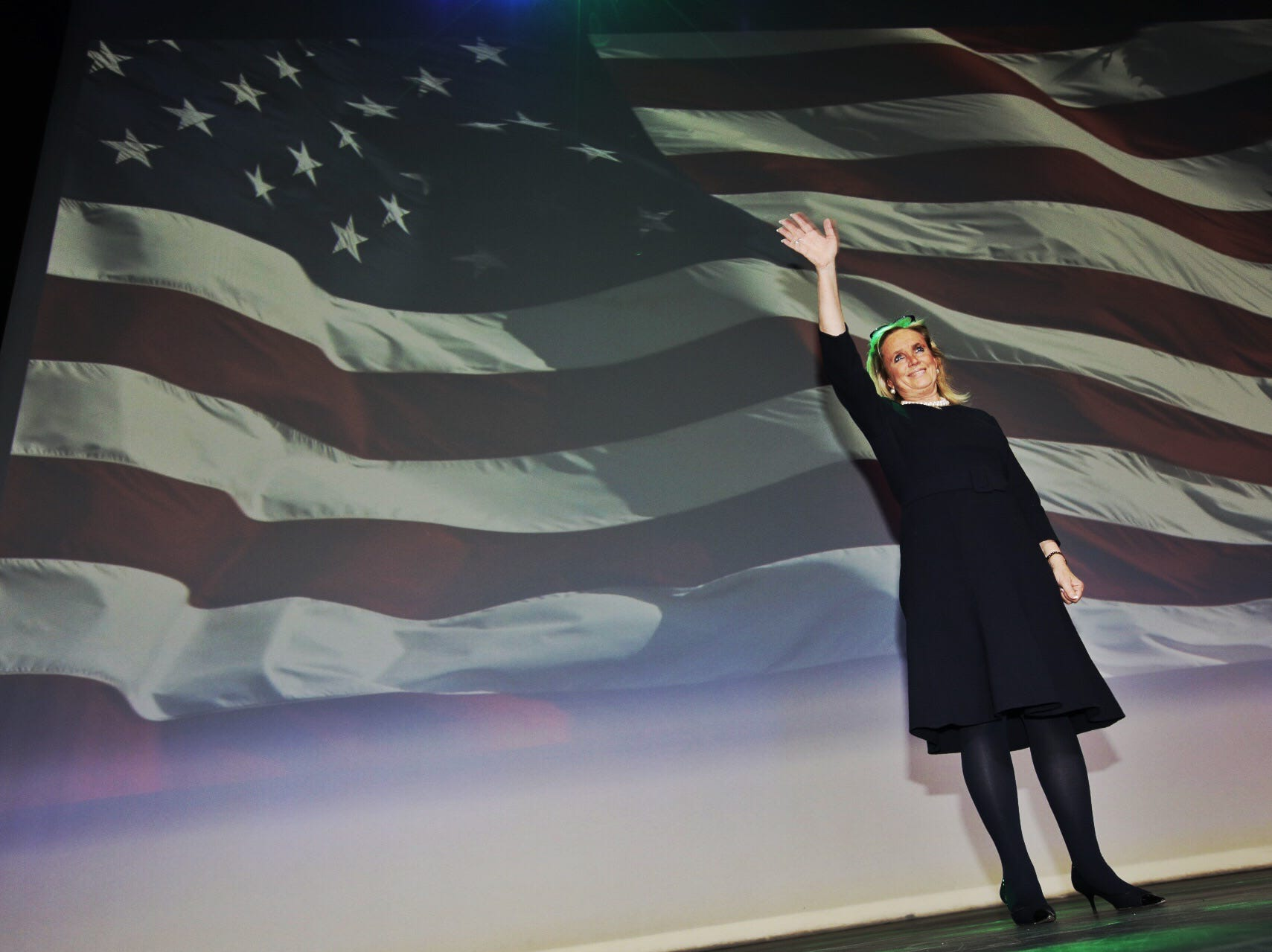 The crowd cheers as Debbie Dingel addresses the crowd during the Democrat's watch party celebration at MotorCity Casino's Sound Board in Detroit on Tuesday, Nov. 6, 2018.