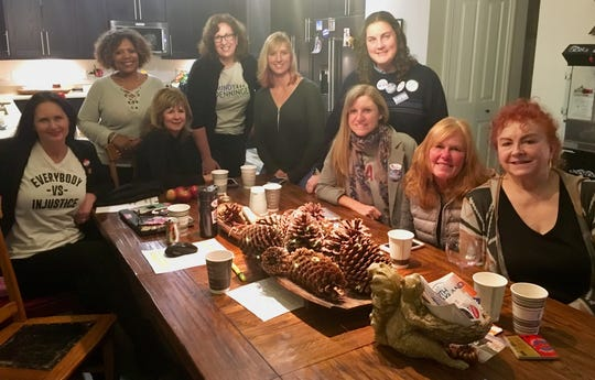 The activists who belong to the North Oakland Women Making a Difference group meet at the Oxford home of Jody and Samantha LaMacchia on Election Night. Many of them spent the day canvassing and making campaign calls. They are Laura Kotasek (left), Debbie Holland, Francine Melotti, Mindy Denninger (who ran for a state House seat), Michelle McClellan (who ran for a county commission seat), Samantha LaMacchia, Jody LaMacchia, Amy Murawka and Barb Hagy-Miller.