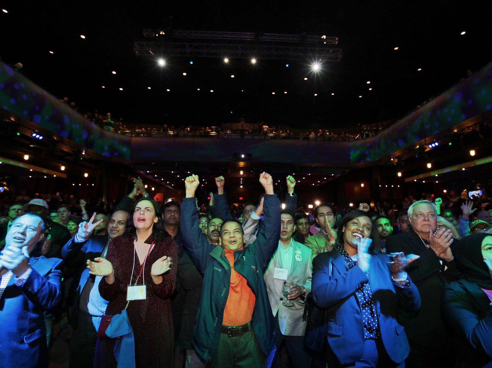 The crowd cheers as Debbie Dingell addresses the crowd during the Democrat's watch party celebration at MotorCity Casino's Sound Board in Detroit on Tuesday, Nov. 6, 2018.