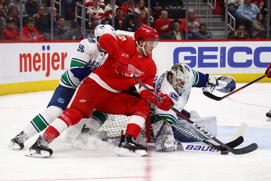 Michael Rasmussen tries to get a shot off on Vancouver goalie Jacob Markstrom during the second period.