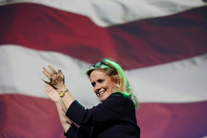 Debbie Dingell walks off the stage after addressing her supporters during the Democratic watch party celebration at MotorCity Casino's Sound Board in Detroit on Tuesday, Nov. 6, 2018.