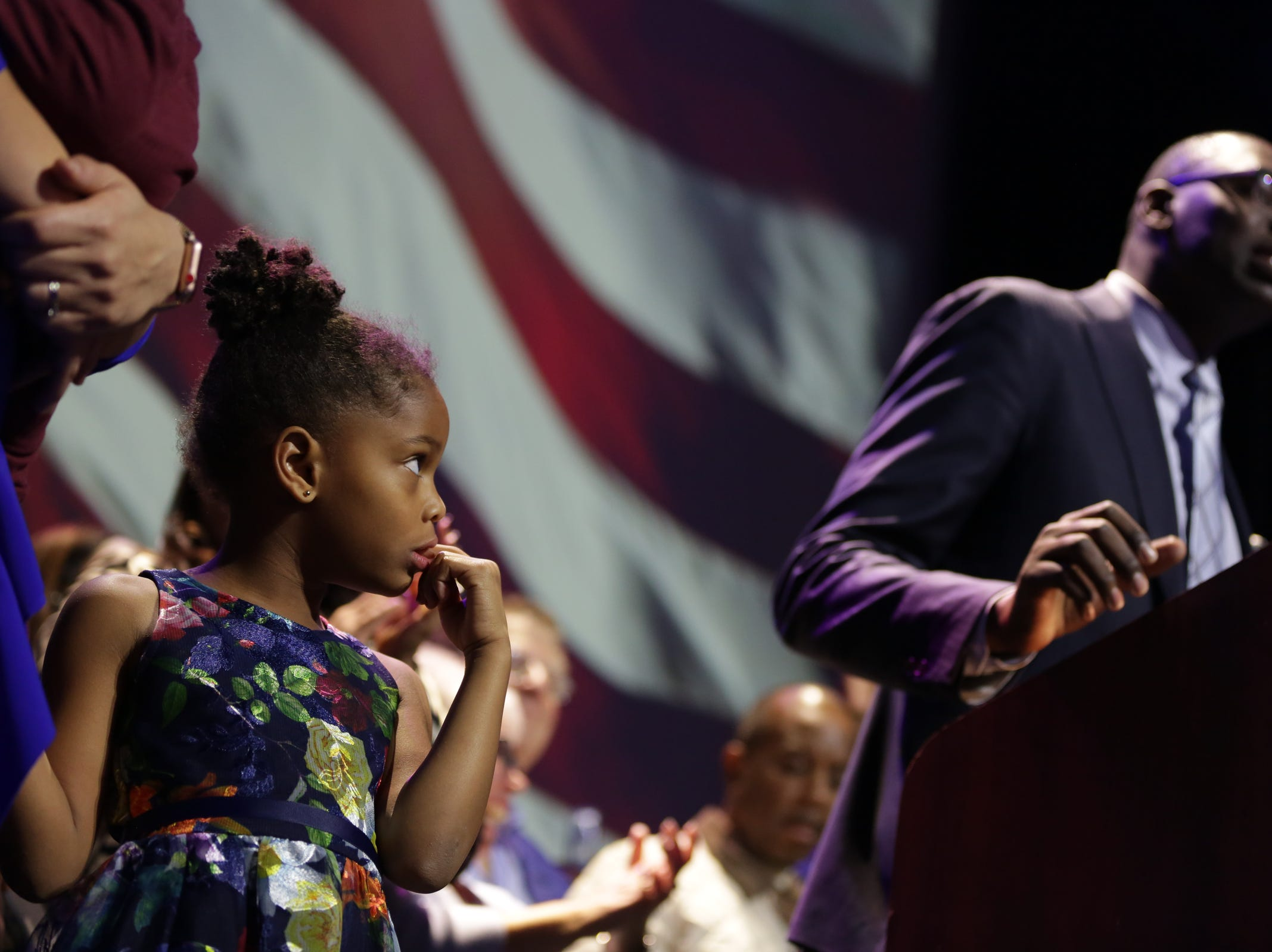 Garlin Gilchrist speaks to the crowd as his daughter looks on while celebrating his victory as Lieutenant governor with Gretchen Whitmer as governor during a celebration at MotorCity Casino's Sound Board in Detroit on Tuesday, Nov. 6, 2018.