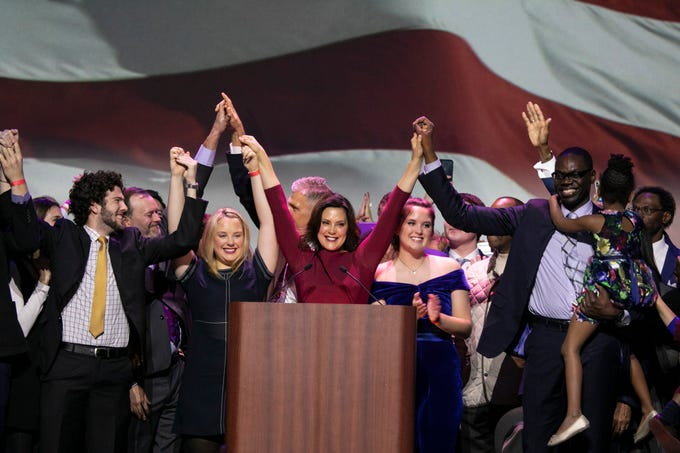 Gretchen Whitmer and her running mate Garlin Gilchrist celebrate their victory during the watch party held at the Sound Board in the MotorCity Casino in Detroit Tuesday, Nov. 6, 2018.