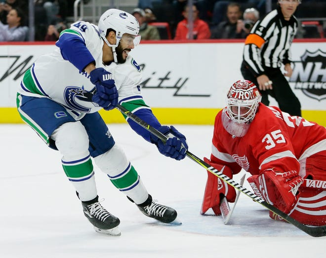 Vancouver Canucks left wing Darren Archibald drives on Detroit Red Wings goaltender Jimmy Howard during the first period Tuesday, Nov. 6, 2018, in Detroit.