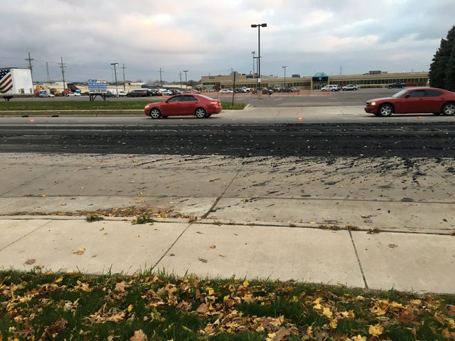 Wayne County and Allen Park officials are cleaning up a pile of sludge that made its way onto Southfield Fwy.