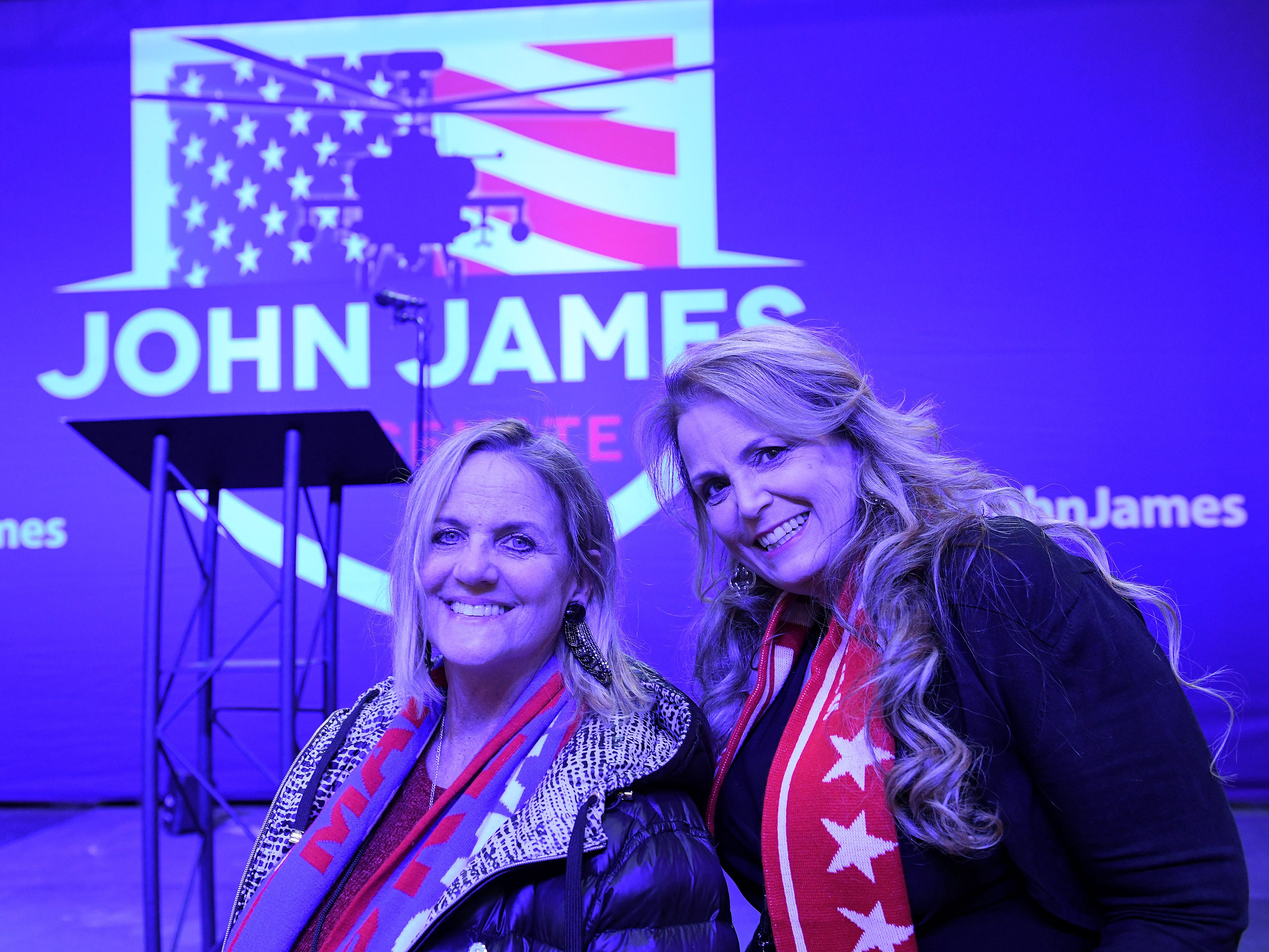 Deborah Richardson of Highland, left, and Vikki Parman of Commerce wait for results to come in at the election night party for U.S. Senate Republican candidate John James in Detroit.