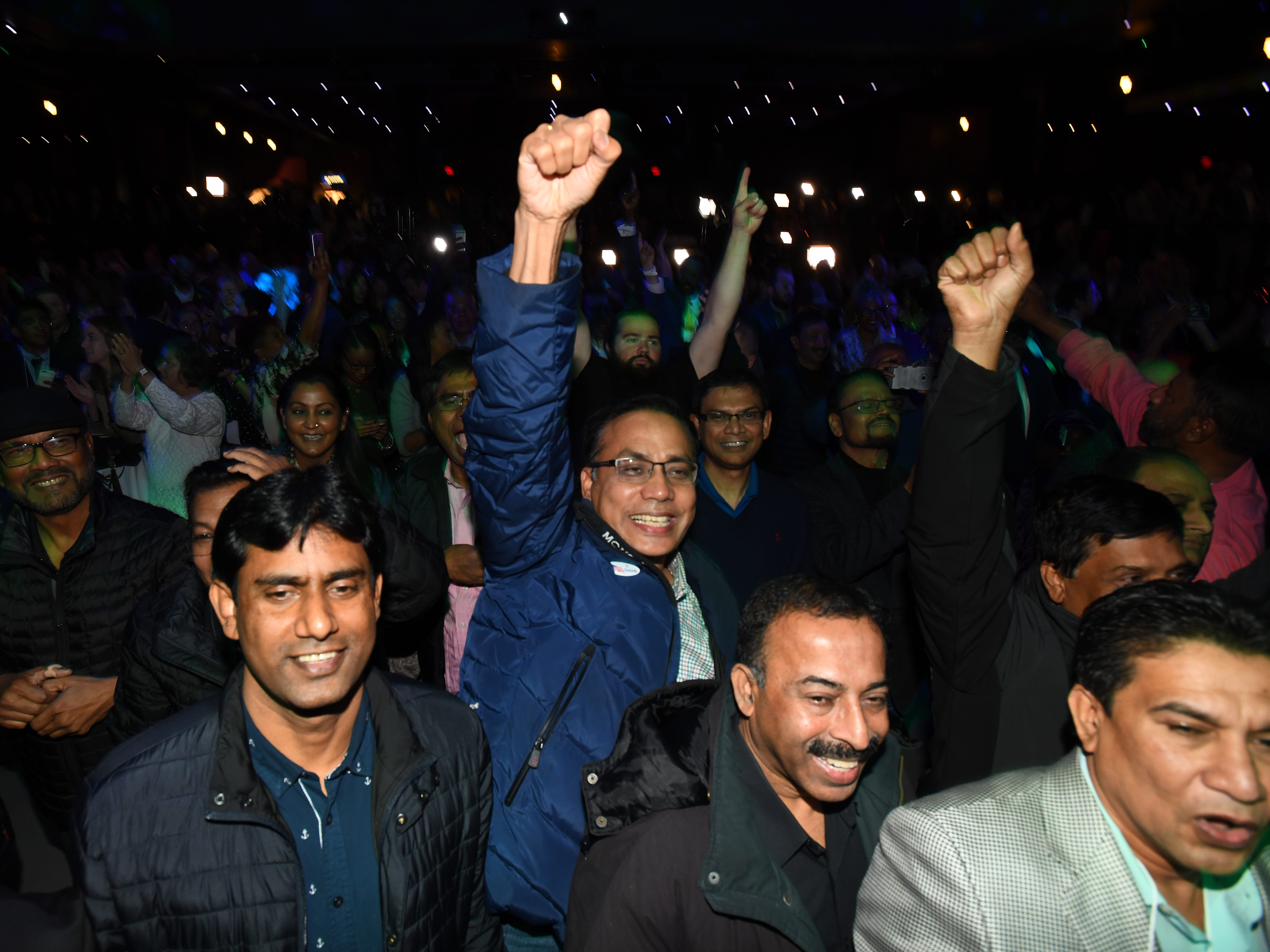 Democrats cheer as the results come in Tuesday night at their party at the Sound Board theater in the MotorCity Casino in Detroit.