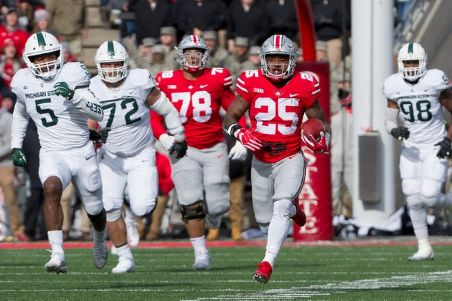 Ohio State running back Mike Weber runs 82 yards for a touchdown in last year's win over Michigan State.