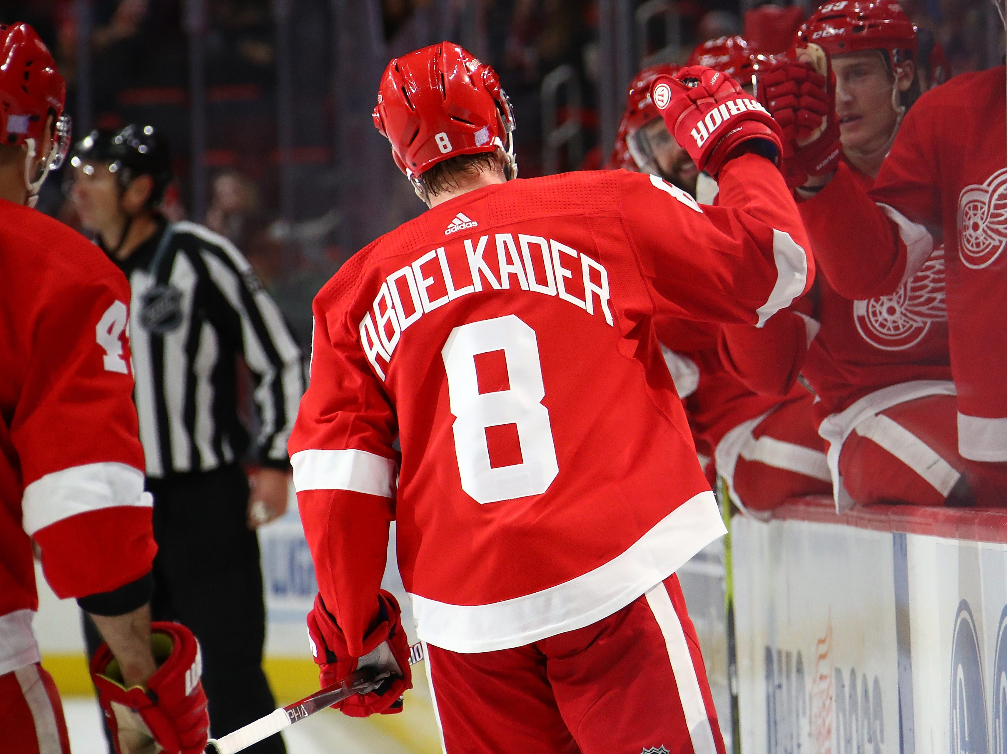 Justin Abdelkader (8) of the Detroit Red Wings celebrates his second period goal with teammates while playing the Vancouver Canucks at Little Caesars Arena on November 06, 2018 in Detroit, Michigan.