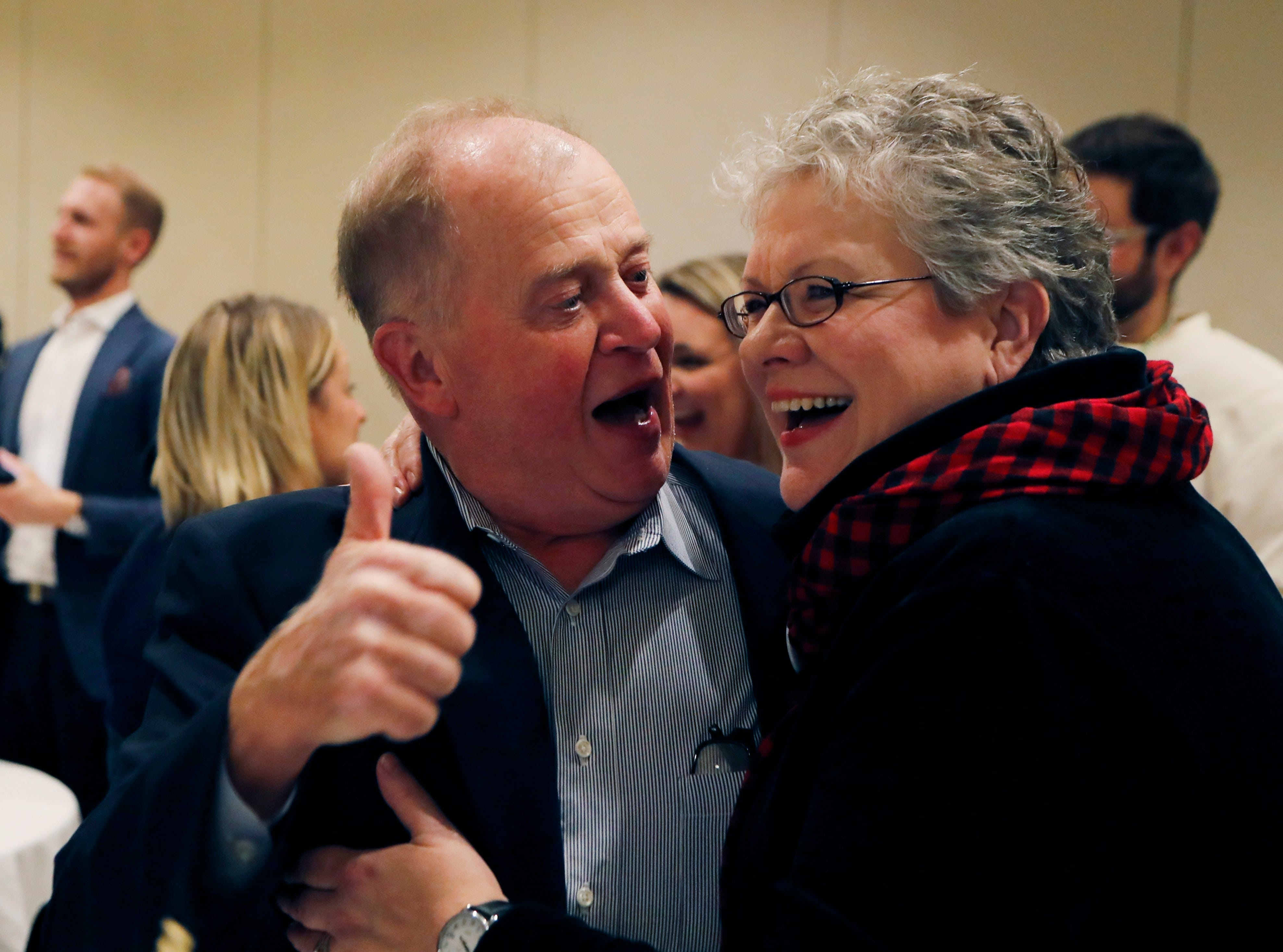 Jim and Maria Stevens react after learning their daughter Haley Stevens was the projected winner for Michigan's 11th Congressional District seat at an election night party in Birmingham.