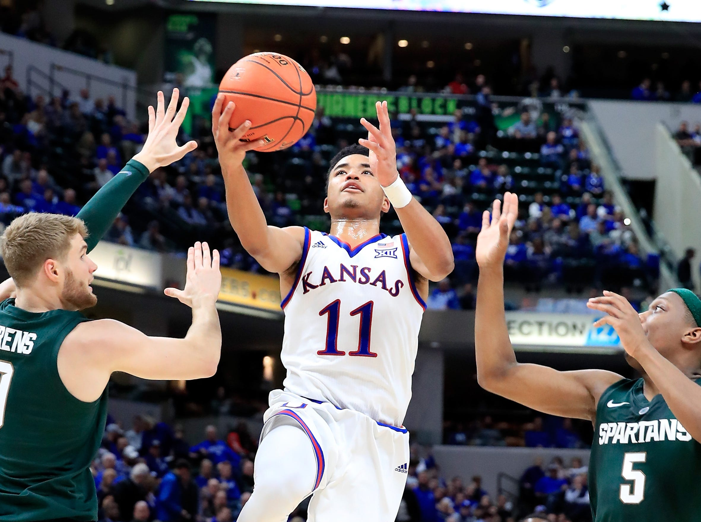 Devon Dotson (11) of the Kansas Jayhawks shoots the ball against the Michigan State Spartans during the State Farm Champions Classic at Bankers Life Fieldhouse.