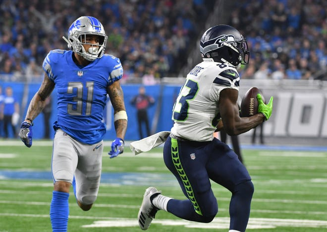According to Pro Football Focus, Lions cornerback Teez Tabor, left, gave up a reception on 22 of 27 targets this past season.