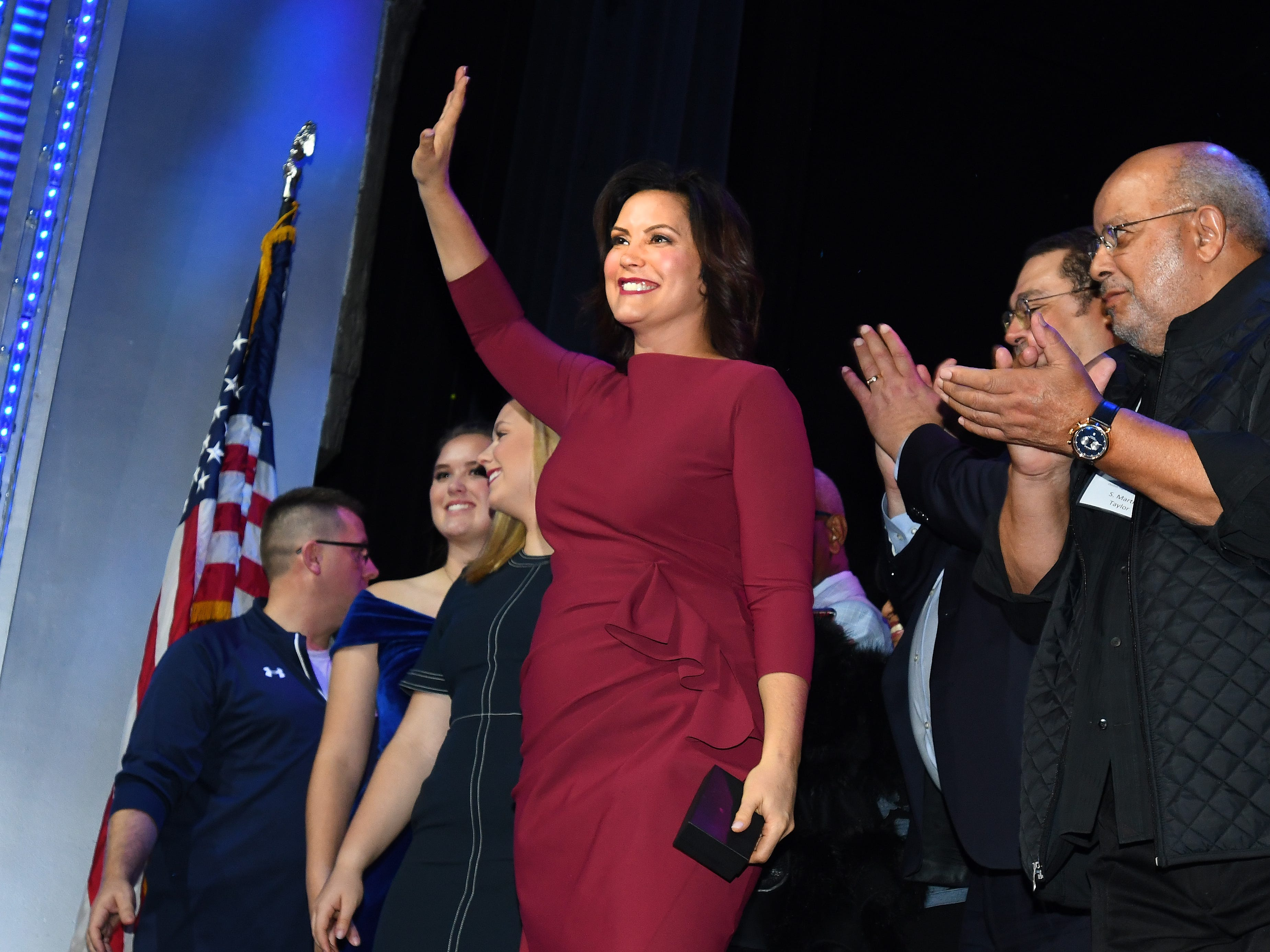 Michigan governor-elect Gretchen Whitmer waves to her supporters with other Democratic Party candidates at the Sound Board theater in the MotorCity Casino in Detroit, Tuesday night.