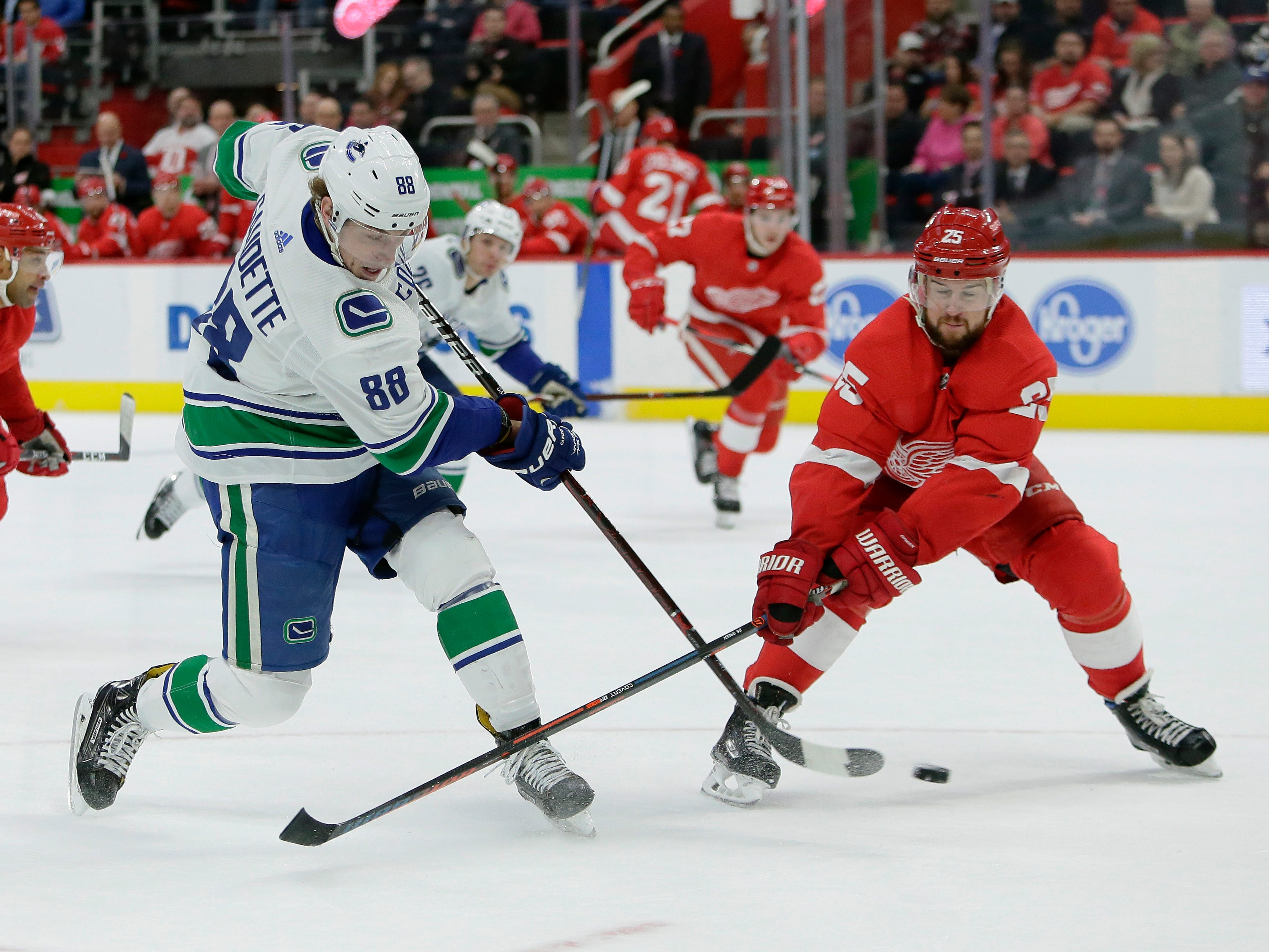 Vancouver Canucks center Adam Gaudette (88) takes a shot on goal against Detroit Red Wings defenseman Mike Green (25) during the first period of an NHL hockey game Tuesday, Nov. 6, 2018, in Detroit.
