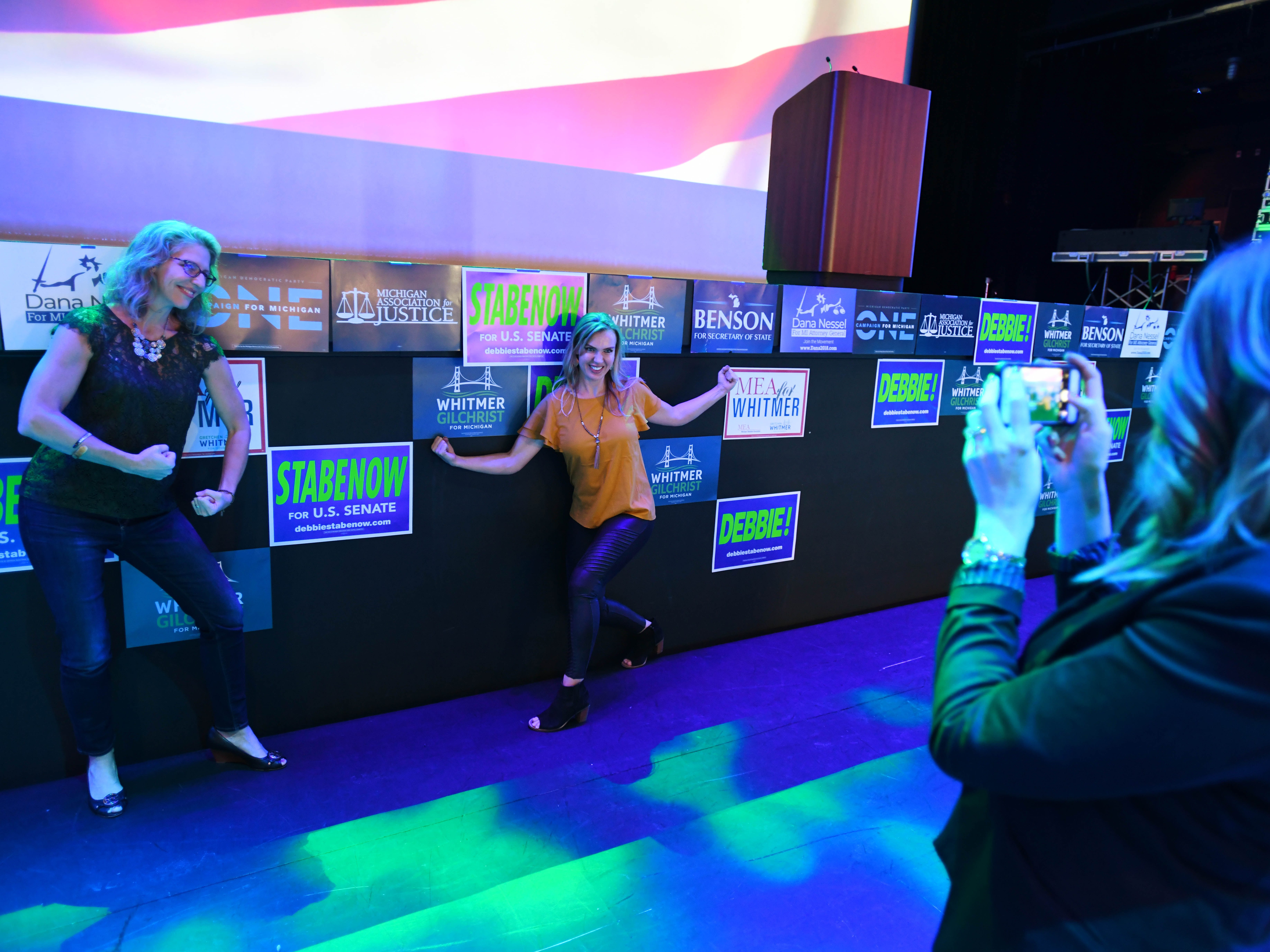Amy Jonker and Andrea Forsyth have fun posing for a  photo taken by Sara Vroman in front of the stage where the Democrats are hoping Michigan gubernatorial candidate Gretchen Whitmer will announce a victory later Tuesday night.  Democrats gathered at the Sound Board theater in the MotorCity Casino in Detroit.