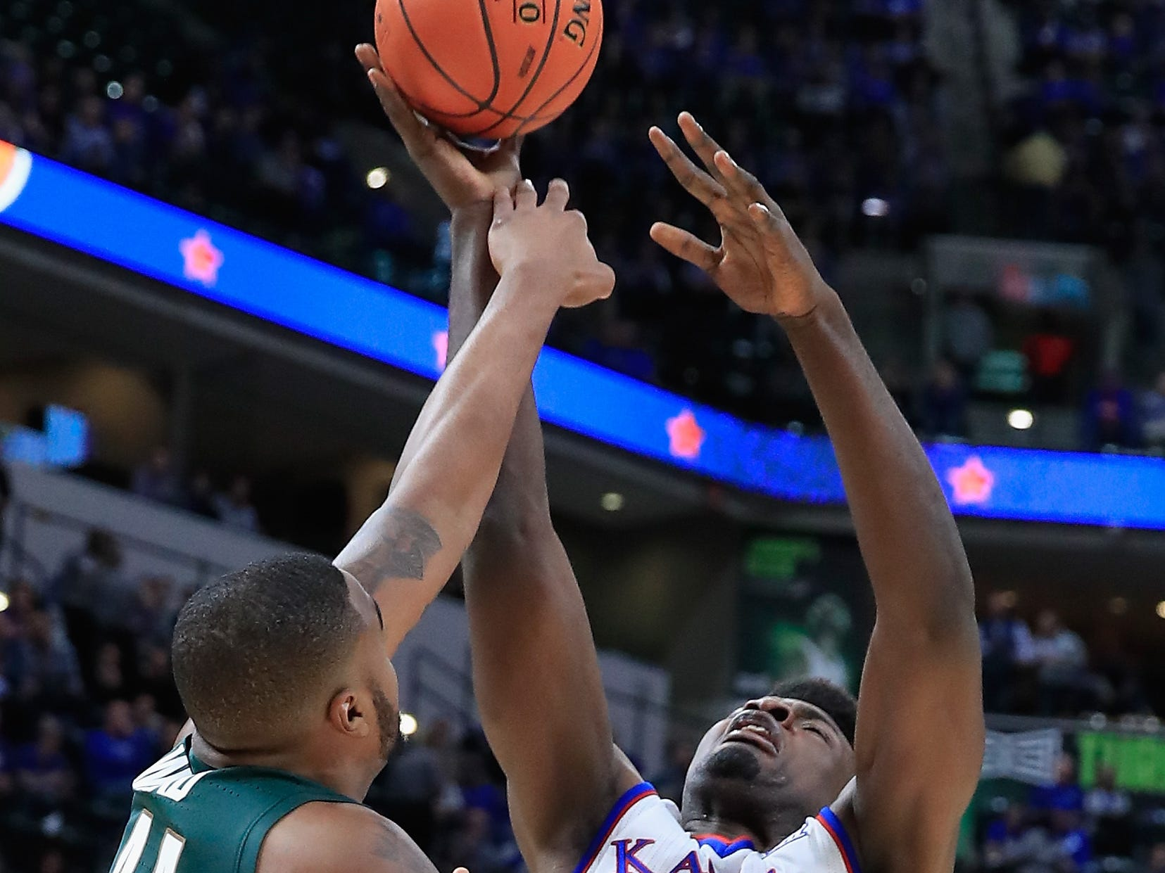 INDIANAPOLIS, IN - NOVEMBER 06:  Udoka Azubuike (35) of the Kansas Jayhawks shoots the ball against the Michigan State Spartans during the State Farm Champions Classic at Bankers Life Fieldhouse.