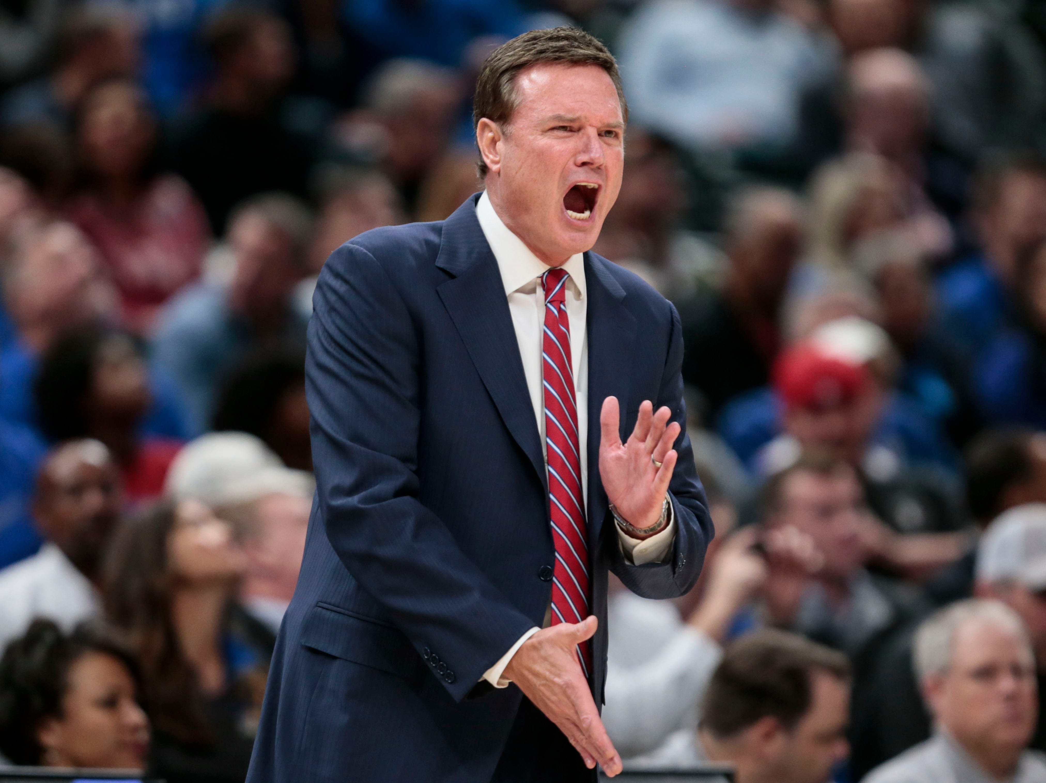 Kansas coach Bill Self yells during the first half of the team's NCAA college basketball game against Michigan State at the Champions Classic in Indianapolis, Tuesday, Nov. 6, 2018. Kansas won 92-87.