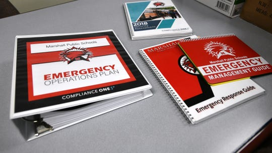 Detailed emergency assessments and planning materials are displayed at the Marshall Middle School on Wednesday, Nov 7, 2018, where security improvements are being funded with a grant from the Michigan State Police. (Dale G.Young/Detroit News) 2018.